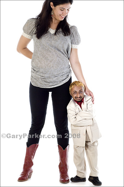 "Romeo, 20, 2 ft. 9"" at 21 pounds, with Emily, 25, 5'2"". Romeo's smile belies a delightfully HUGE, outgoing and humorous personality, typical within Primordial Dwarfism"