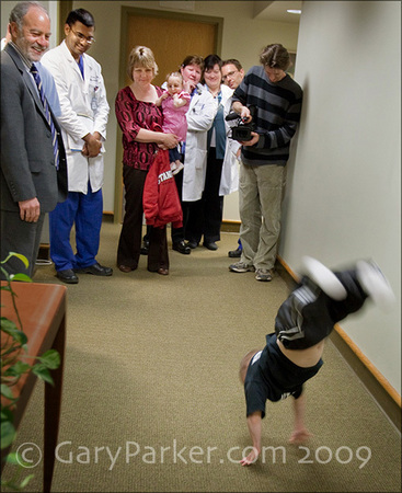 9 months after 3 brain surgeries, Brad does a run of back flips down Stanford Neurosurgery department hallways at the request of renowned neurosurgeon Dr. Gary Steinberg, at left, as  other neurosurgeons observe in disbelief.   3 weeks after this checkup, Brad won the State Championship in AAU Tumbling/Floor Exercise!!!! (the one for tall, advanced gymnasts)