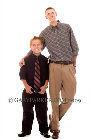"Sean Kongs, at 5'  the tallest achondroplastic dwarf I've ever met - possibly the tallest legitimate dwarf in the world - with 6'11"" brother Ryan.  Sean & Ryan's Dad is 6'9"".  These guys got  a double dose of genetics!"