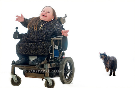 Gracie Oliver, Parastramatic Dwarfism, one of LPA's most delightful personalities, with her traveling kitty Jasmina.  Gracie typifies the happy, optimistic, inspiring spirit of many Little People.