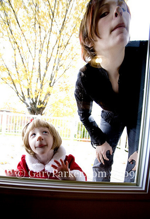 Kenadie (age 4) and Mom press their noses on the window