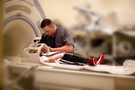 Brad Jordan, 18, being prepped for an MRI at Lucille Packard's Children Hospital at Stanford University.  Brad, a 35 pound Primordial Dwarf, won the state championship in Tumbling - the one for TALL advanced athletes - only 9 months after 3 brain surgeries at Stanford.