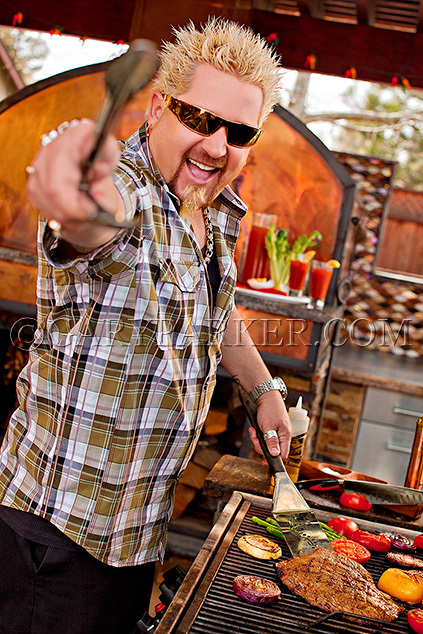 TV chef/wildman Guy Fieri - restaurateur, author, television personality, and game show host - for a magazine cover on summer BBQing.