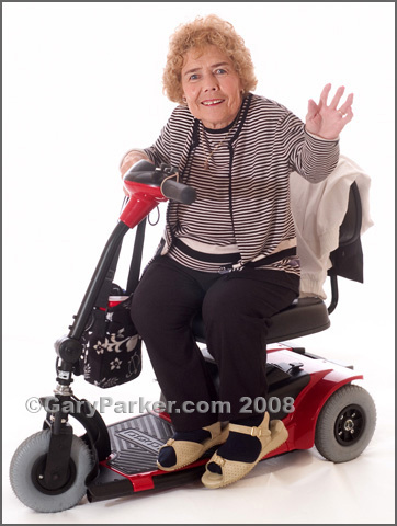 Betty Binkley, Diastrophic Dysplasia.  Many Little People use scooters to get around more quickly.