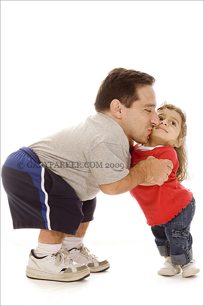 "Mark Trombino with daughter Priya, both of whom have dwarfism type SEDc.  Mark is 39""; Priya, 5, is 26""."