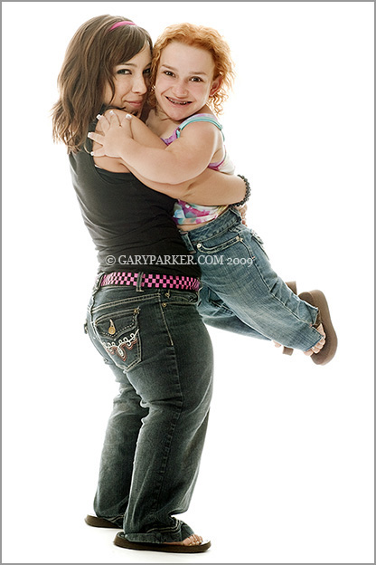 "2'10"" Cassee Cannata, Cartilage Hair Hypoplasia Dwarfism, gets a lift from friend Sara Zimmerman whose Pseudoachondroplastic Dwarfism makes her a compartively tall 4'."