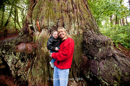 Mother Shelly holds Nick, an 18 year old Primordial Dwarf, in front of the mammoth 1800 year old Methuseleh Tree the day before brain surgery for 3 aneurysms at Stanford, with speical thanks to Dr. Gary Steinberg and his incredible surgical & support team!