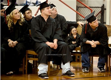 Bridgette graduated from high school in 2009.  Bri tends to stand out - or get lost - in a crowd, as is evident in this image of her with graduating classmates.  In crowded public places Bri must be protected from being bumped into or accidentally stepped upon.