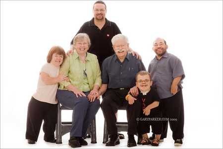 David Hill, 2nd from right, has a dwarfism type which is combination of his parents types.  Mom Shirley Hill, left, has Achondroplasia; Dad Jonathon Hill, right, has Acrolarangeal Syndrome.  Pictured with average height Grandparents and Uncle