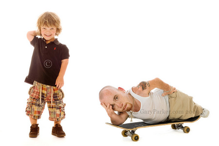 Lewie Pierson, right, born with Diastrophic Dwarfism, fits neatly on a skatebaord.  The young boy at left (ID to come) has Achondroplasia.  90% of all Little People have Achondroplasia.