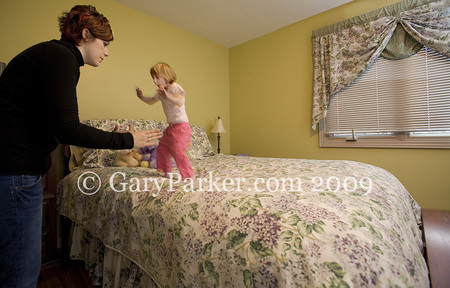 Kenadie (age 4) and Mom jump on bed